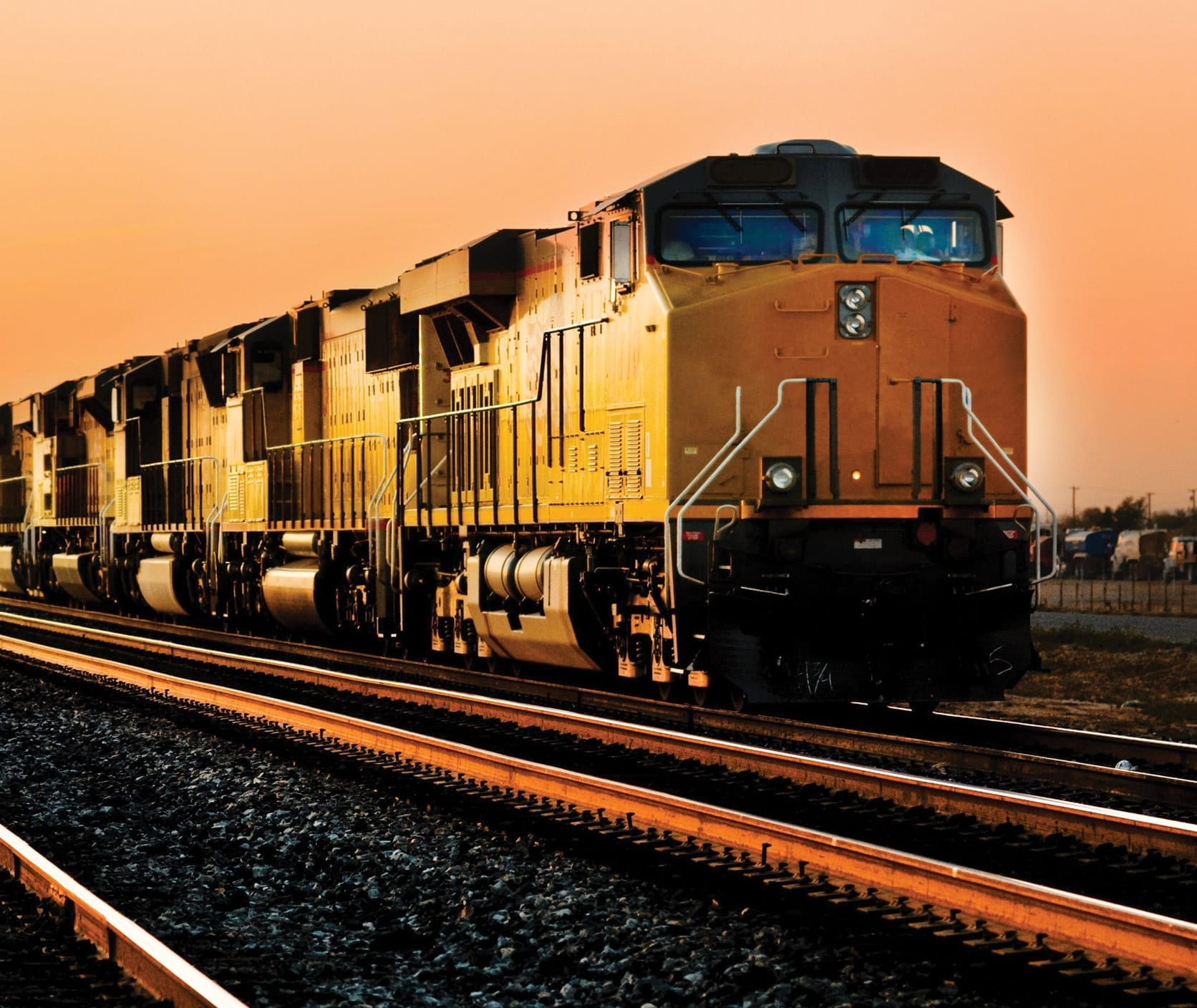CSX train on railroad track traveling at dusk