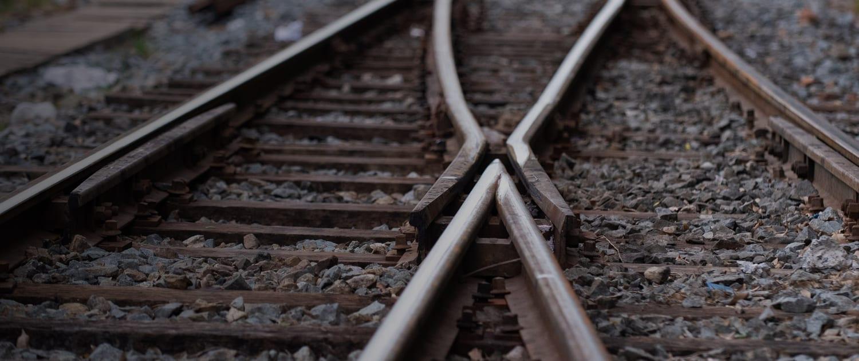 close up view of railroad tracks at dusk