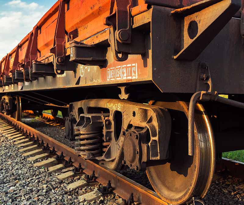close up of rusting rail car in middle of day