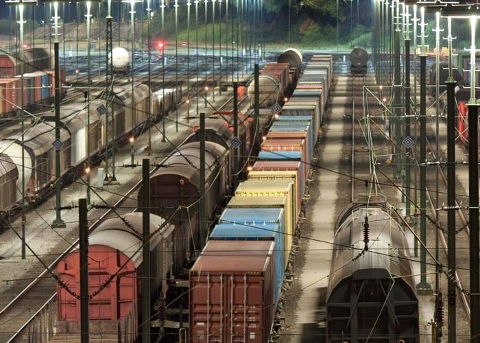 rail yard at night under lights