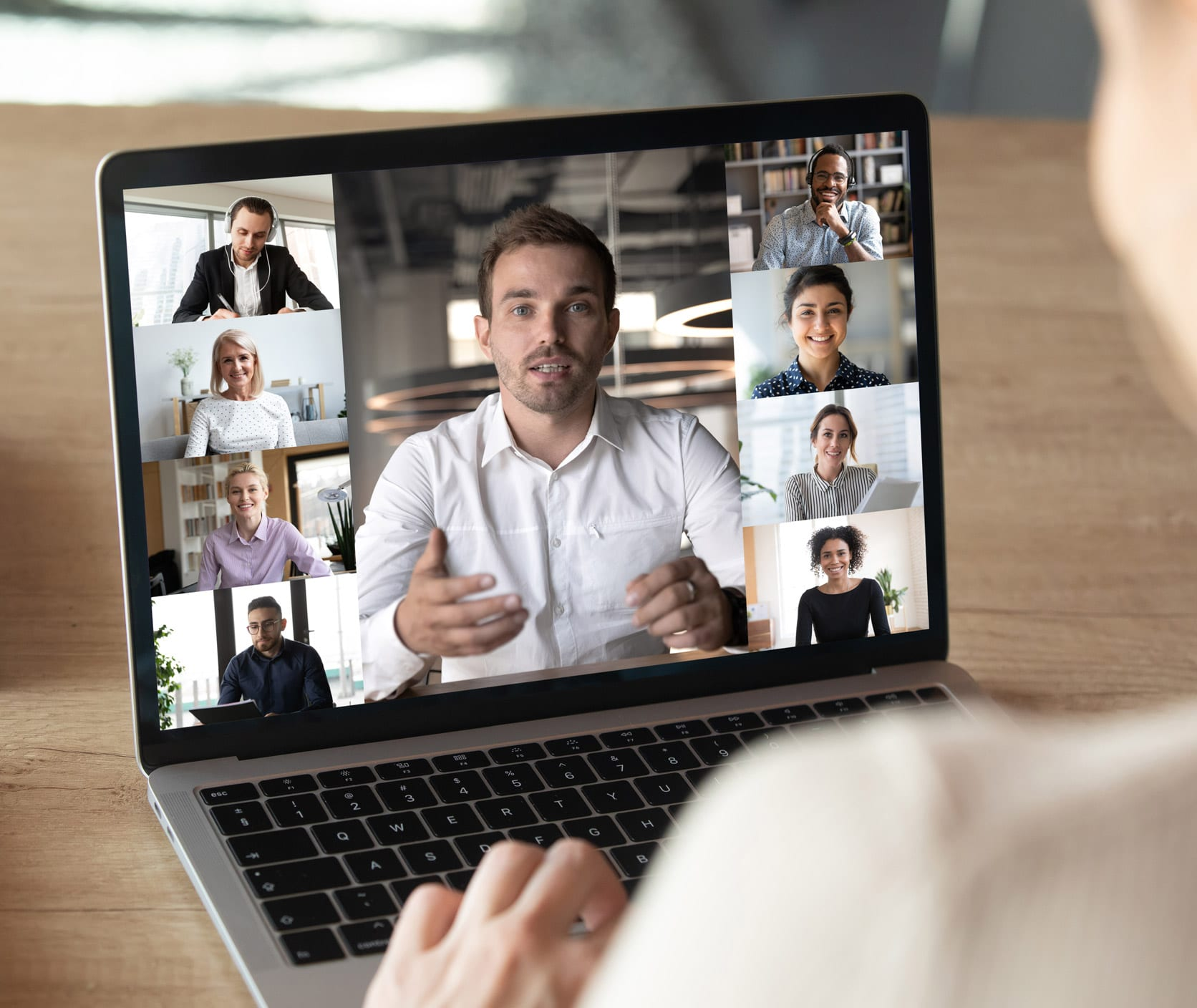 video meeting on laptop with man speaking to everyone
