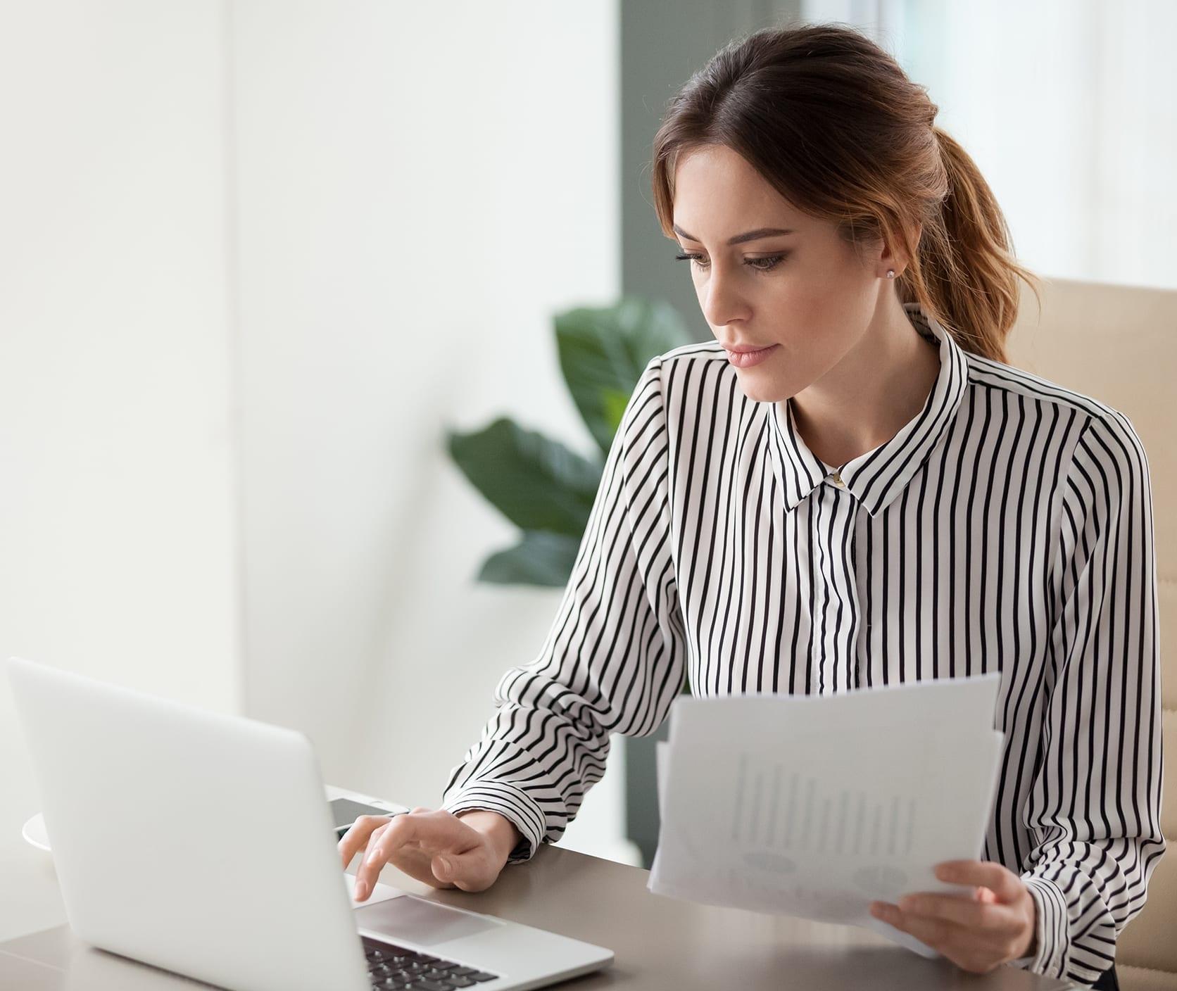 woman on laptop analyzing spending